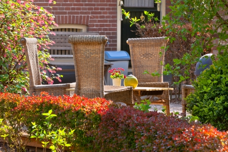 Wicker chairs in the front garden. Very cozy and rustic.