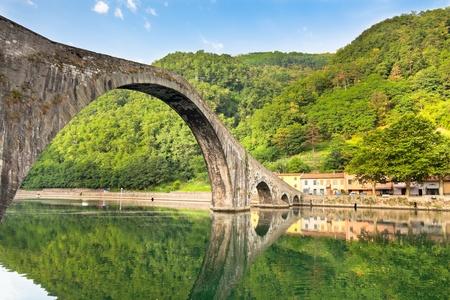 Maddalena Bridge at Bagni di Lucca, Tuscany, Italy. Also known as the Devil's Bridge Stock Photo - 15844129