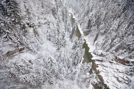 Snowy forest and river view from above Stock Photo - 15976998