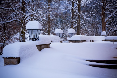 White landscape: snowy lamps near house in the woods.�Toned and vignetted image as postcard Stock Photo - 15976281