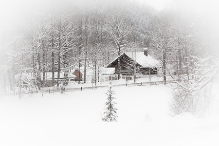 White landscape: snowy Alpine house in the woods. Toned and vignetted image as postcard