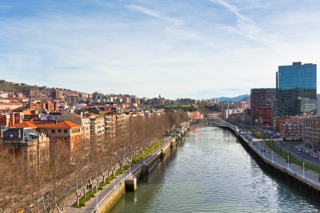 View of Bilbao, Vizcaya, Spain. Calatravas Footbridge Zubizuri in perspective Stock Photo