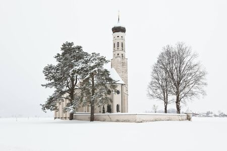 Beautiful Alpine bavarian Church after morning snowfall in mountain village Stock Photo - 15977112