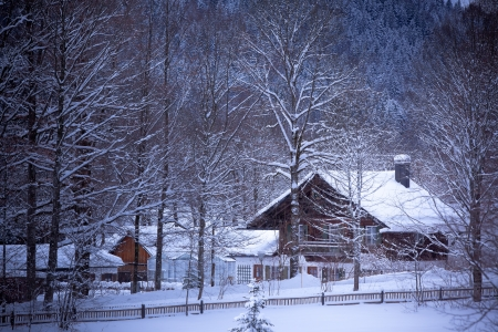 chalet: Fairy tale landscape: snowy Alpine house in the woods.�Toned and vignetted image as postcard