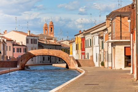 Comacchio (Ferrara, Emilia Romagna, Italy). Canal with bridge and colorful houses. photo