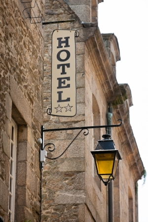 Hotel Sign on Old Stone Building in France. Toned image Stock Photo