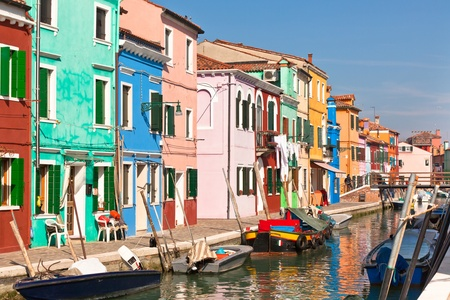 Colorful houses along canal in the island of Burano near Venice, Italy photo