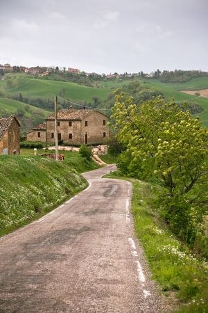 vignetted: Italy Farmhouse and Local Curve Road  Toned and vignetted image Stock Photo