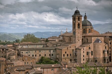 vignetted: Old Urbino, Italy, cityscape at dull day. Horizontal toned and vignetted image