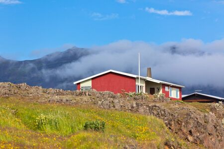Red Small House in East Iceland. Horizontal shot Stock Photo - 16584889