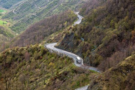 Long Winding Road Through Italian Mountains Landscape. View from above photo