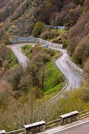 Winding Road Through Italian Mountains Landscape. View from above photo