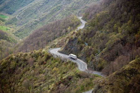 Long Winding Road Through Italian Mountains Landscape  View from above photo