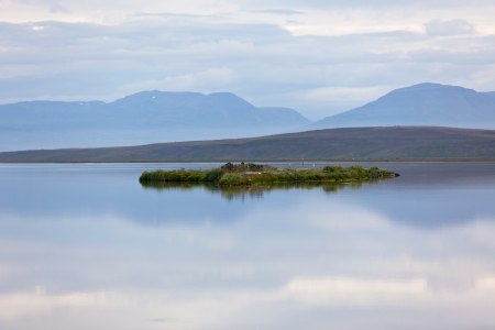 Iceland Landscape with Smooth Lake and Sky Reflection Stock Photo