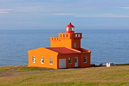 North Iceland Sea Landscape with Orange Lighthouse and Blue Sky