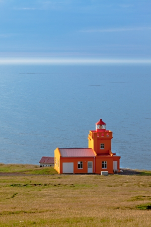 North Iceland Sea Landscape with Orange Lighthouse and Blue Sky Stock Photo - 16679607
