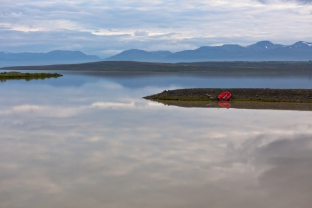 Iceland Landscape with Red Boat and Reflection in the Water Stock Photo - 16676502