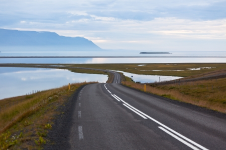 Curve Road through sea lagoon at twilight at North Iceland. Stock Photo - 16676503