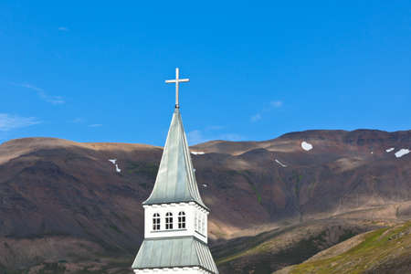 Iceland Church Steeple on bright blue sky and mountains background Stock Photo - 16676504