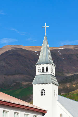 Iceland Church on bright blue sky and mountains background Stock Photo - 16676505