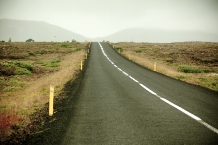 Highway through Iceland landscape at foggy day. Toned vignetted image Stock Photo - 16815036