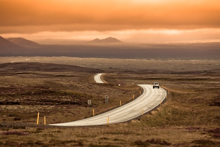 Curve Highway through Iceland landscape. Toned image photo