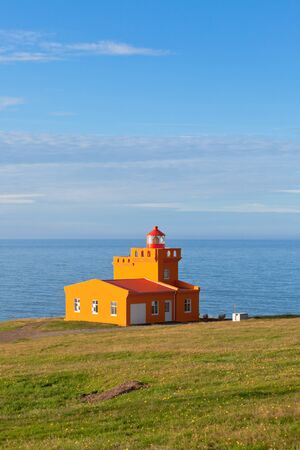 North Iceland Sea Landscape with Orange Lighthouse and Blue Sky Stock Photo - 16815037