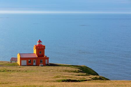 North Iceland Sea Landscape with Orange Lighthouse and Blue Sky Stock Photo - 16815019
