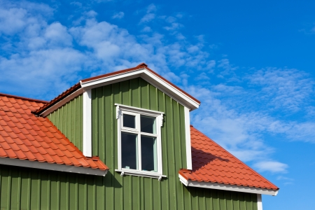 Residential Roof Top under the Bright Blue Sky. Copyspace photo