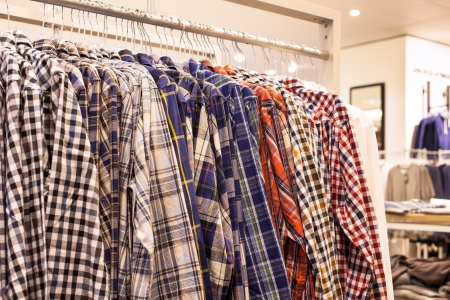 Clothing in Fashion Store - Checkered Men Shirts on the Store Rack