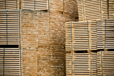 New Stacked Pallets at Wood Factory. Horizontal toned shot Stock Photo
