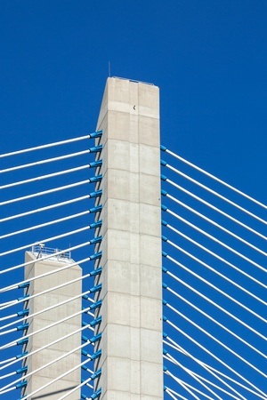 Modern bridge fragment: white cables against bright blue sky Stock Photo - 17185434