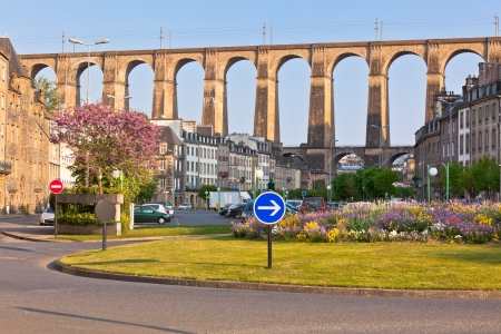 Large stone bridge in Morlaix town, Brittany, France at sunny evening Stock Photo