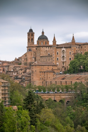 vignetted: Old Urbino, Italy, Cityscape at Dull Day. Vertical toned and vignetted image