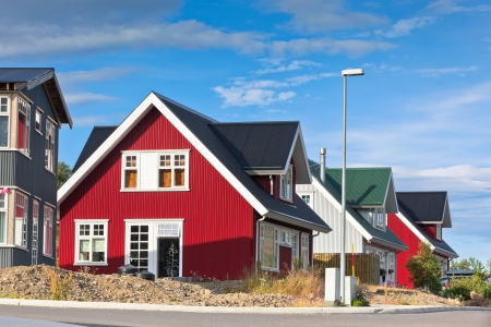 Bright Siding Houses in Small Iceland Town. Sunlight and Blue Sky Stock Photo - 17546905