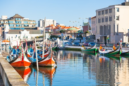 Aveiro, Portugal view. Bright Painted Gondolas at canal Stock Photo