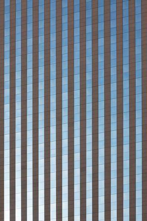 degrade: Glass Skyscraper Building Facade as Background. Vertical shot