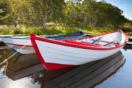 Floating Wooden Boats with Reflection in a Water. Horizontal shot photo