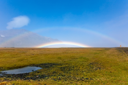 South Icelandic mountain landscape under a blue bright sky with double rainbow photo