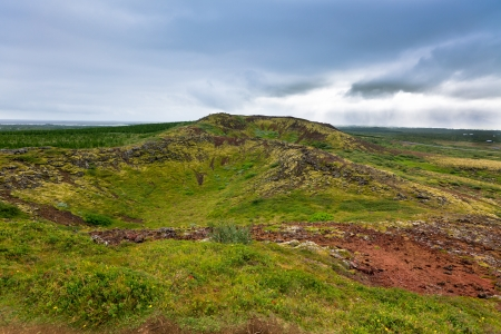 Crater of old extinct volcano in Iceland Horizontal landscape\ at bad weather