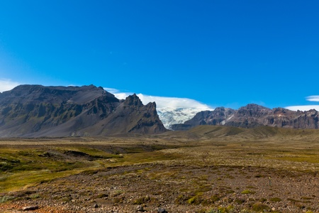 South Icelandic mountain landscape under a bright blue summer sky photo