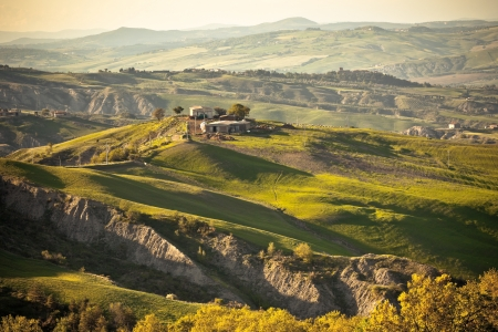 Outdoor Tuscan gold hills landscape at sunset  Horizontal shot Stock Photo