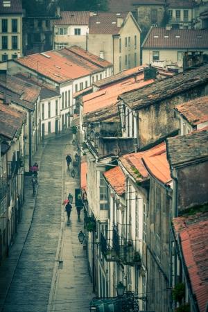 Looking down onto the Rainy Street of Old Town Santiago de Compostela, Spain Stock Photo