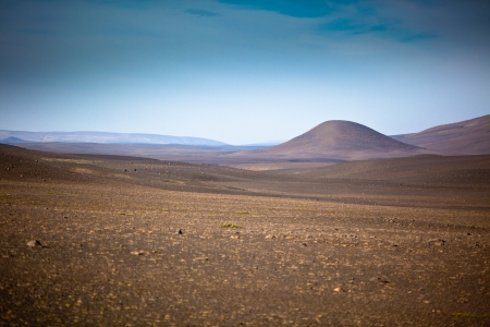 vignetted: Dry Gravel field landscape under a blue summer sky. Highlands of Central Iceland. Small GRIP and vignetted image