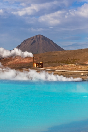 Geothermal Power Station and Bright Turquoise Lake in Iceland at Summer Sunny Day photo