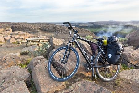 Bike with active equipment at Iceland mountains scene. Horizontal shot photo