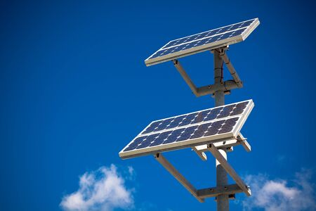Solar panels on bright blue sky background. Renewable Energy. Horizontal shot photo