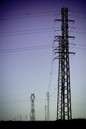 Electricity Power Pylons silhouettes. Filtered shot photo
