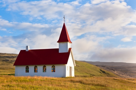 Typical Rural Icelandic Church under a blue summer sky. Horizontal shot photo
