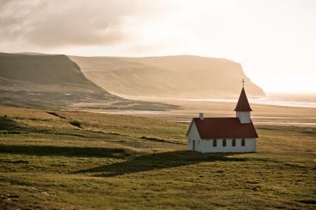 Typical Rural Icelandic Church at Sea Coastline. Horizontal shot Stock Photo